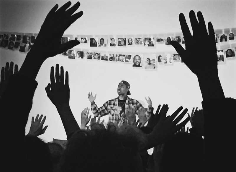 SUBMITTED PHOTO - For the final 'HANDS UP' monologue, LaTevin Alexander had the audience members hold their hands up during his entire  performance.