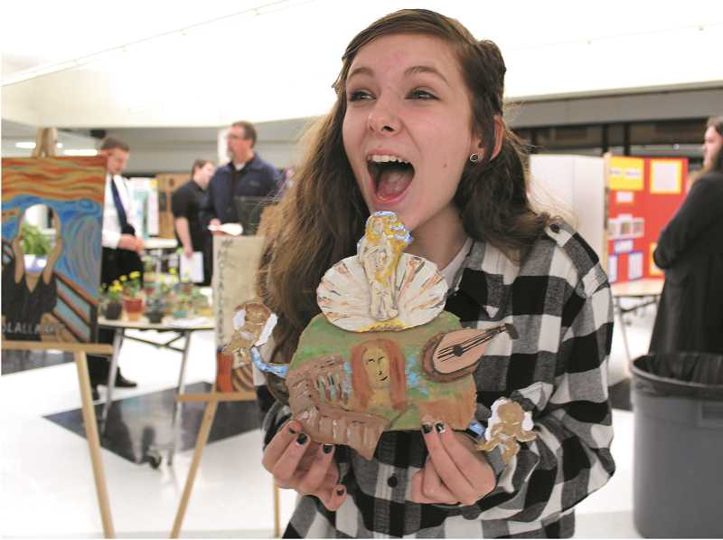 PIONEER FILE PHOTO - A Molalla High School student shows off her artwork during the 2015 annual Showcase Night at the school. This year's Showcase will be from 6-8 p.m. Monday, Nov. 7, in the school commons.