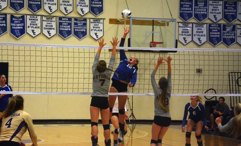 TIMES FILE PHOTO - Valley Catholic junior Lizzy Osborn and Regan Dean combined for 33 of the Valiants 42 kills.