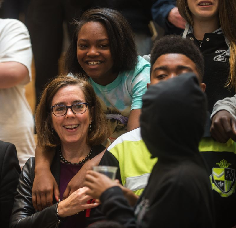 OUTLOOK PHOTO: JOSH KULLA - Gov. Kate Brown chats with students at the dedication of Open School East in Gresham.