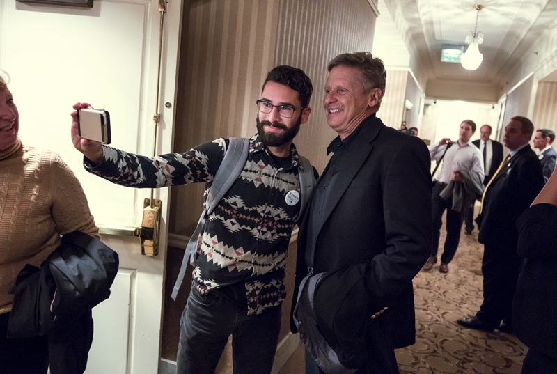 TRIBUNE PHOTO: JONATHAN HOUSE - Karlo Hernandez takes a selfie with Libertarian presidential candidate Gary Johnson during a campaign stop Thursday evening in Portland.