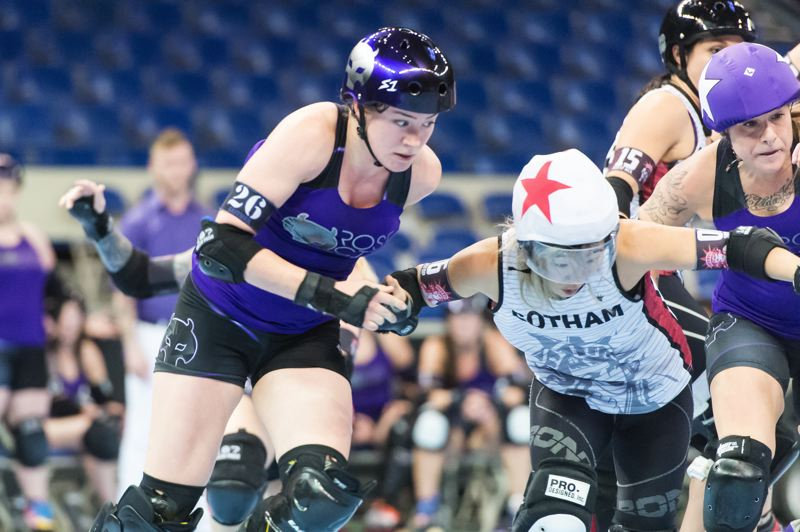 TRIBUNE PHOTO: CHRISTOPHER OERTELL - Sarah Gaither of the Rose City Rollers' Wheels of Justice looks to make a move against Gotham in Sunday night's championship bout at Memorial Coliseum.