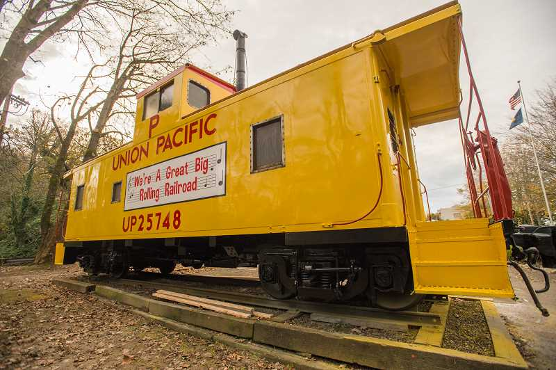 OUTLOOK PHOTO: JOSH KULLA - A vintage Union Pacific caboose at the Troutdale Depot Park Rail Museum has now been restored to its original colors.