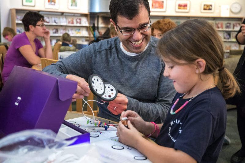 TIMES PHOTO: JONATHAN HOUSE - Steve Sethi and his daughter Anna learn about how electricity conducts during a Makerspace event at the Tualatin Library.