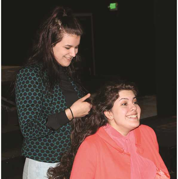 CONNER WILLIAMS - Senior London Chaffin (left) plays the lead role of Truvy Jones as she does the hair of senior Casey McGuire's character while they rehearse their lines.