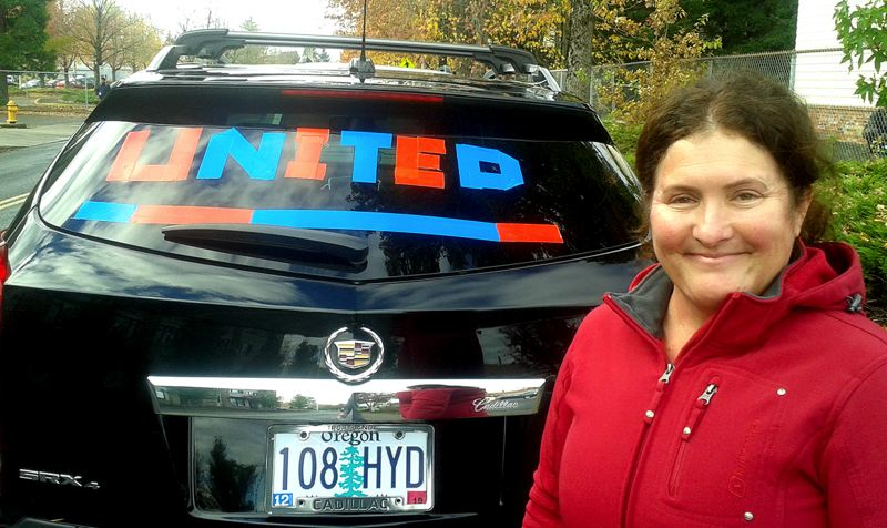 PAMPLIN MEDIA GROUP: SHANNON WELLS - Longtime Gresham resident Julie Sunderland decided to spend the day after the election tooling around town with the word 'United' taped in the back of her SUV.
