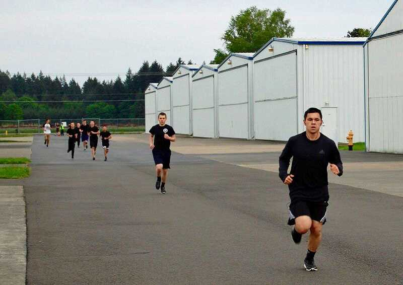 SUBMITTED PHOTO - Simon Chuang completes a mile run as part of Civil Air Patrols physical training requirements for all cadets. 'He must meet a time standard based on his age, gender and grade (often referred to as 'rank') within CAP,' Aurora Composite Squadron Captain Marc Minato says. 'He is not competing against the other cadets.'