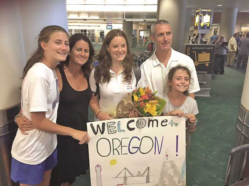 SUBMITTED PHOTO - Exchange student Lolly Pasotti found her host family waiting for her when she arrived in Portland from Brescia, Italy, in August. That's McKinley and Molly Mullins to Lolly's left, Pat and Reilly Mullens to her right.