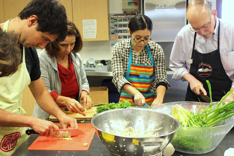 TIDINGS PHOTO: PATRICK MALEE - Tjahaja taught students how to delicately chop the vegetables as part of the preparation process.