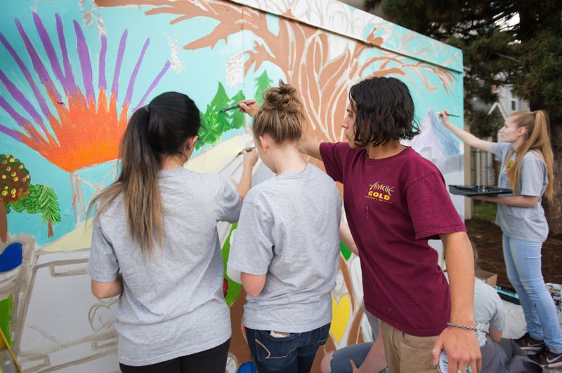 OUTLOOK PHOTO: JOSH KULLA - Marcos Restrepo, right, an Mt. Hood Community College student and Gresham High School graduate, is an artist who was enlisted to help guide Youth Advisory Committee members through the mural project.