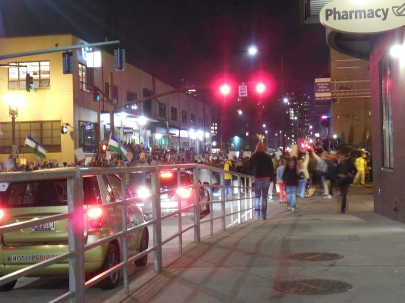 PAMPLIN MEDIA GROUP: JOSEPH GALLIVAN - NotMyPresident protesters crossed the Broadway Bridge around 9.45 p.m. Thursday, Nov. 10, and paused at the corner of Northwest Lovejoy Street and 13th Avenue during several hours of protest downtown.