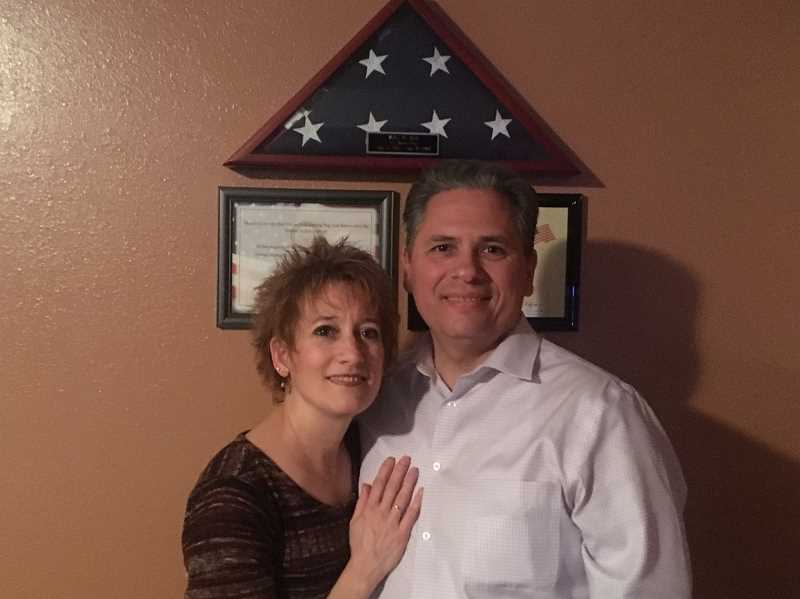 Cindy Meek celebrates the results of the Nov. 8 election with her husband, State Rep.-elect Mark Meek (D-Gladstone/Oregon City), under his father's American flag.