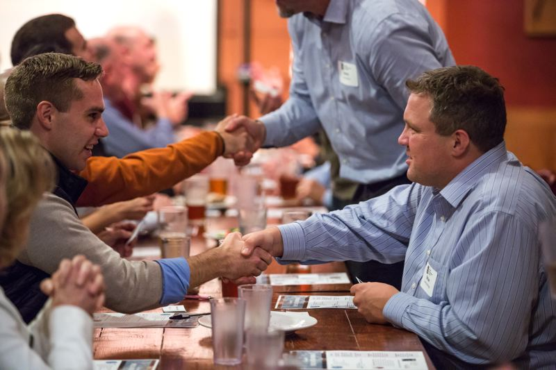 PAMPLIN MEDIA GROUP: JONATHAN HOUSE - Attendees at an Oregon Entrepreneurs Network event called Speed Networking! face off at the Lucky Lab Northweston a recent November evening. They had three minutes to see how close they could get to exchanging business cards.