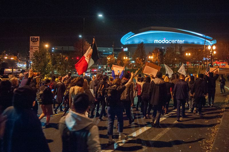 TRIBUNE PHOTO: DIEGO DIAZ - Protesters march near the Moda Center during one of five nights of rallies and marches following Tuesday's election of Donald J. Trump as president.