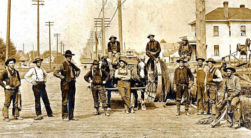 COURTESY OF GARRY WILSON  - In the early 1900s, telephone service was expanding - and workers were installing telephone and power poles across Americas open land at a time when few roads were paved or passable in the winter. This team or gang of linesmen was stringing wires beside the Columbia River, barehanded. Garry Wilsons grandfather, Franklin Wilson, who once lived in Sellwood, was one of the men in this picture.