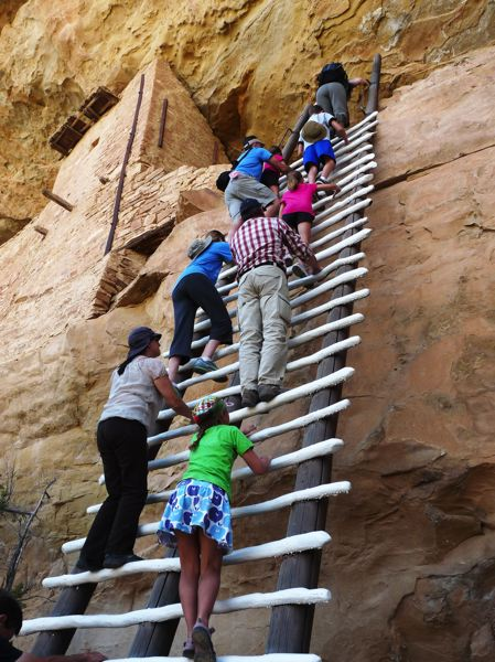 CONTRIBUTED PHOTO - This U.S. National Parks photo shows tourists climbing the steep ladder at Mesa Verde, the ruins of the Ancestral Pueblo people near Cortez, Colo.
