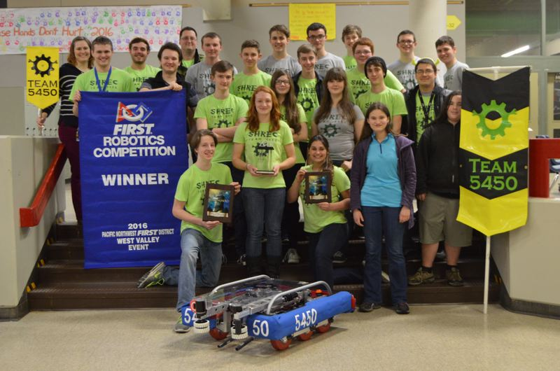 SPOTLIGHT FILE PHOTO - Members of the St. Helens Robotics and Engineering Club pose for a photo after winning the Pacific Northwest Regional Championships in March. The club is launching a new fundraising project this month to help pay for competition fees for the upcoming season.