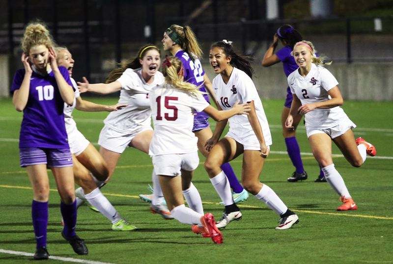 DAN BROOD - Sherwood's (from left) Lindsay Howard, Hailee Rasmussen, Emma Smith, Loma McNeese and Kailen Fried celebrate following McNeese's goal during Saturday's Class 6A state championship match.