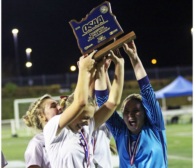 DAN BROOD - Sherwood seniors (from left) Kennedy Clay, Lindsay Howard and Madison Reimer hold up the title trophy.