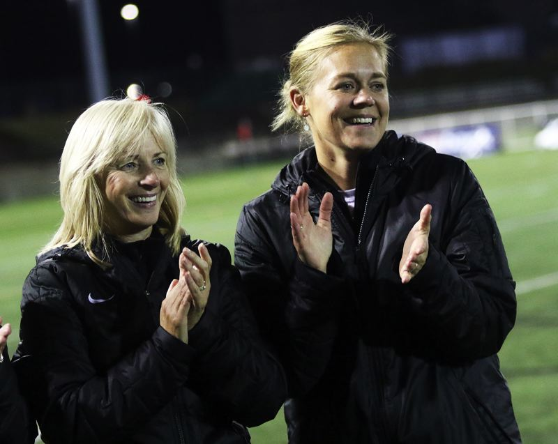 DAN BROOD - Sherwood High School coaches Geraldine Rumpf (left) and Katie Hartman are all smiles following Saturday's state championship match.
