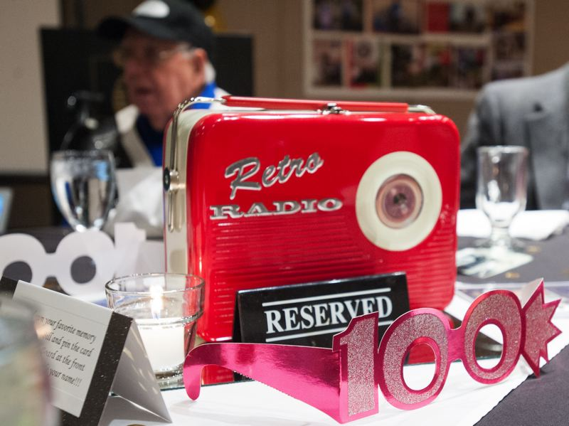 OUTLOOK PHOTO: JOSH KULLA - Bill remembers when the first radio reciever was installed on top of the Musselshell school. 'All we got was squeaks and sqawks,' he recalled later. These retro radios were placed at each table as a reminder of those days.