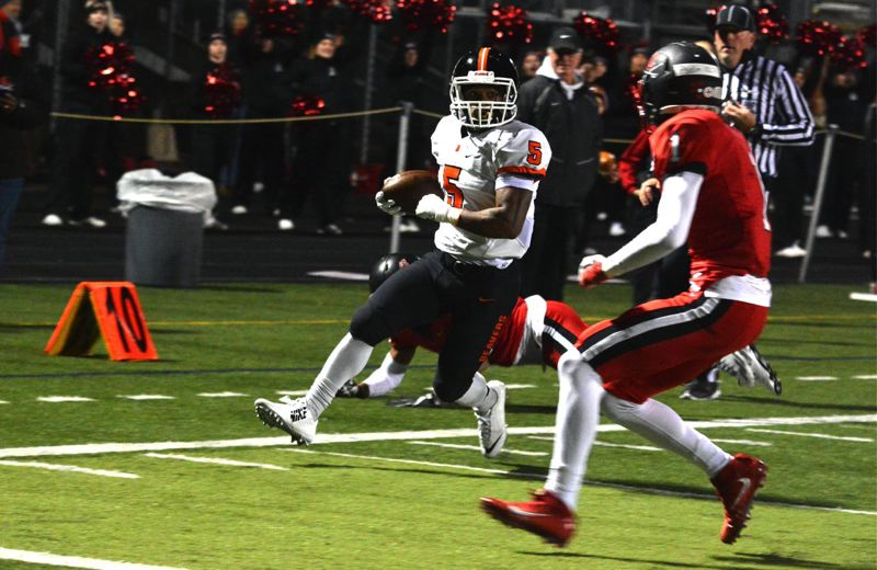 TIMES PHOTO: MATT SINGLEDECKER - Beaverton senior running back Anthony Albright makes his way to the end zone against Clackamas in the Class 6A quarterfinals on Friday.