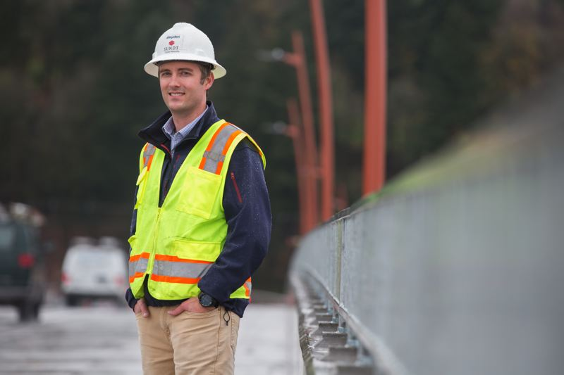 TRIBUNE PHOTO: JONATHAN HOUSE - Dustin Murphy, project engineer with Sundt Construction and project manager on the Sellwood Bridge, moved with his family to Portland to work on the Sellwood Bridge.
