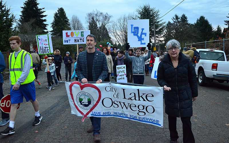 REVIEW PHOTO: VERN UYETAKE - Lake Oswego City Councilor Jon Gustafson and Councilor-elect Theresa Kohlhoff head out from George Rogers Park during Friday evening's walk for peace, love and diversity.