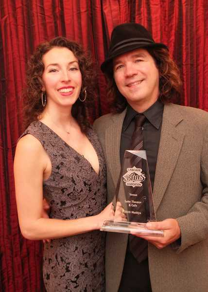 SUBMITTED PHOTO: TONY KUTTER - Dean Mueller and Julie Yanko, who perform as Julie Amici, pose with the award Lake Theater and Cafe for Best Venue awarded by the Cascade Blues Association.
