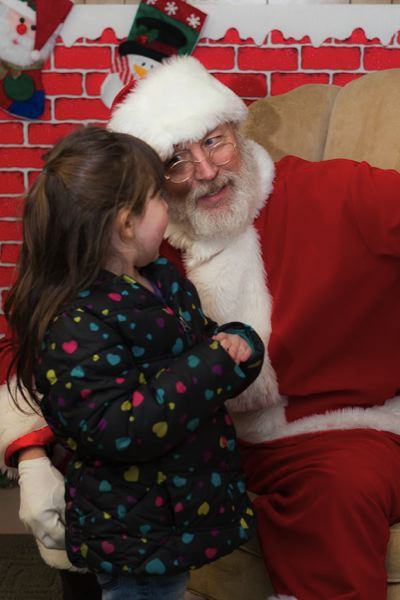 CONTRIBUTED PHOTO - Santa will be in the house to visit with youngsters at several community Christmas tree lighting events. See the listing for times and locations.