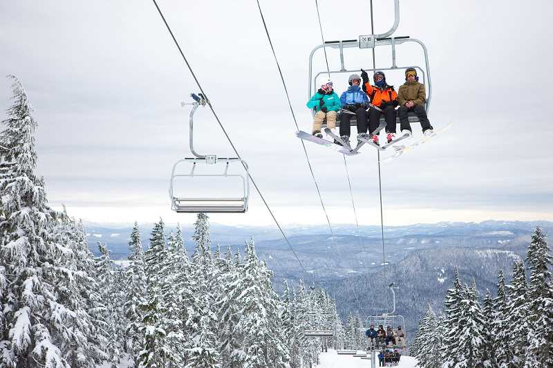 PAMPLIN MEDIA GROUP FILE PHOTO - A group of snowboarders ride the ski lift at Timberline Lodge.