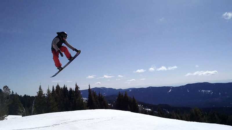 PAMPLIN MEDIA GROUP FILE PHOTO - Snowboarder Adam Jenkins gets major air while skiing on Mt. Hood.