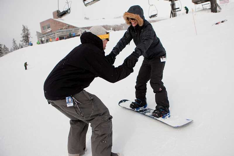 PAMPLIN MEDIA GROUP FILE PHOTO - Ben Johnson gives a snowboarding lesson to Jamie Carlton during her first downhill experience at Timberline in 2011.