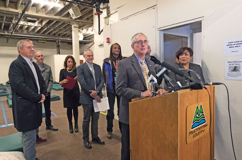 PORTLAND TRIBUNE: JAIME VALDEZ - Mayor Charlie Hales, shown at the microphone, joined county, nonprofit and business leaders to announce the new shelter.