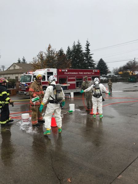 PHOTO COURTESY: CLACKAMAS FIRE - Participants in the training exercises practice decontamination.