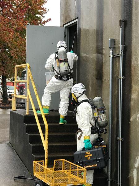 PHOTO COURTESY: CLACKAMAS FIRE - Oregon National Guard and Clackamas Fire District #1 personnel make entry into a building during a joint training exercise.
