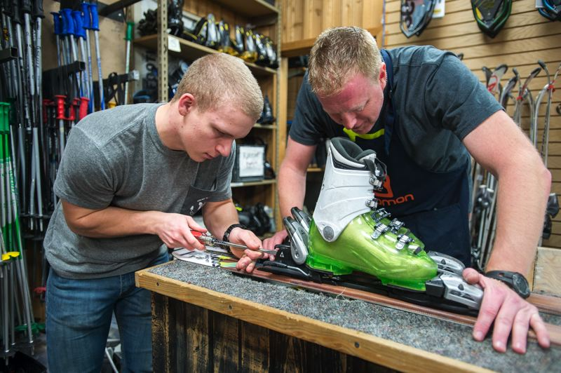 OUTLOOK PHOTO: JOSH KULLA - Hillcrest Ski and Sports employee Matthew Johnson works on adjusting ski bindings under the watchful eye of  shop technician Scott Schrepping. The Gresham shop is gearing up for the 2016-17 ski season.