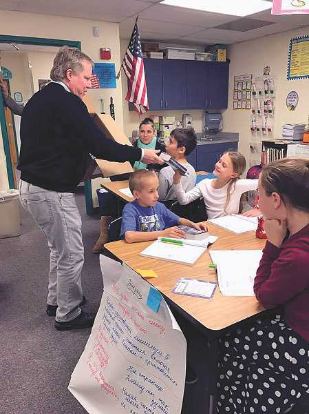 Woodburn Rotary donates dictionaries to fourth-graders