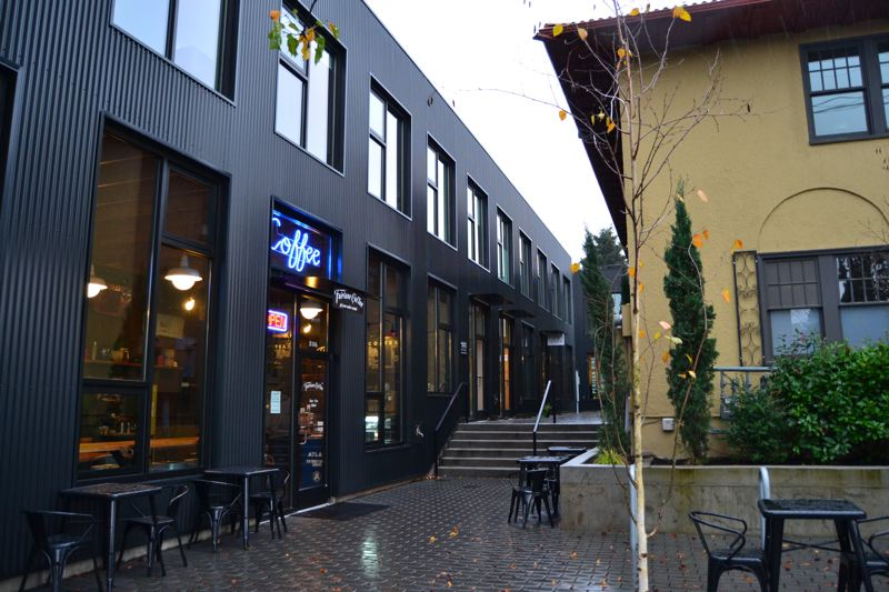 JULES ROGERS - Milwaukie Way was completed this summer as two buildingsin an L-shape with a cobblestone pedestrian backalley through the shopping scene.