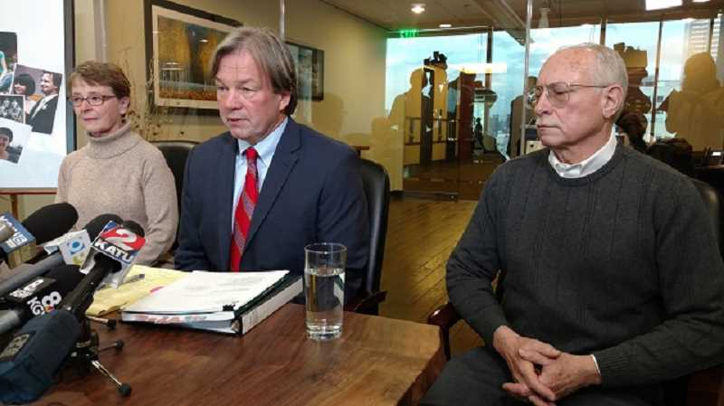 COURTESY KOIN 6 NEWS - Mary and Russ Pitkin flank attorney Tim Jones when they filed a wrongful death lawsuit over the death of their daughter, Madaline, in the Washington County Jail.