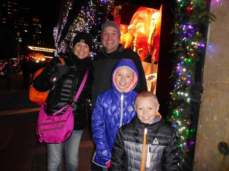 PHOTO COURTESY OF JENNIFER O'GORMAN  - The organizers of the Legacy Retreat had arranged for the O'Gorman family to have a front-row view of the lighting of the Saks Fifth Avenue window display and light show.Pictured left to right: Jennifer, Pat, Merritt and Graeme.