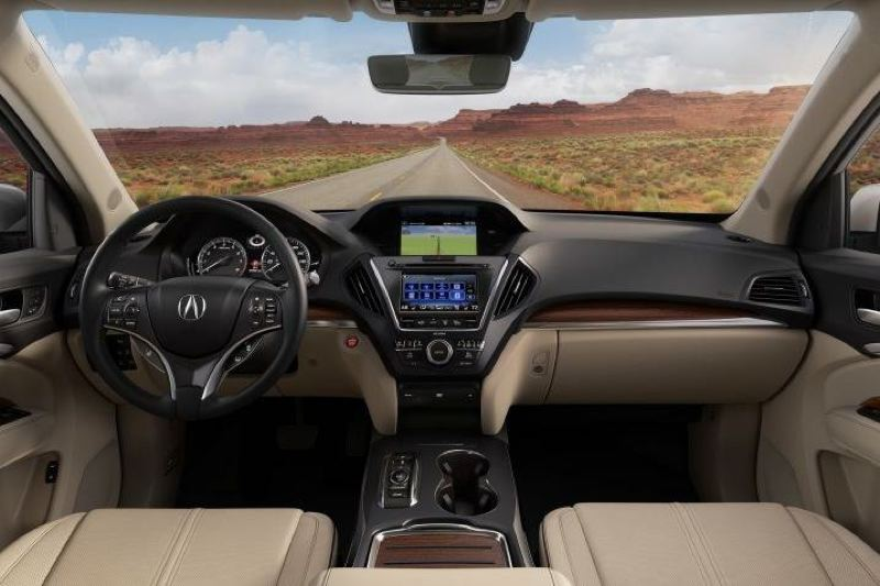 AMERICAN HONDA MOTOR COMPANY - The dual display screen set up in the 2017 Acura MDX reduces the number of button and knobs on the dash for a clean and relatively simple look.