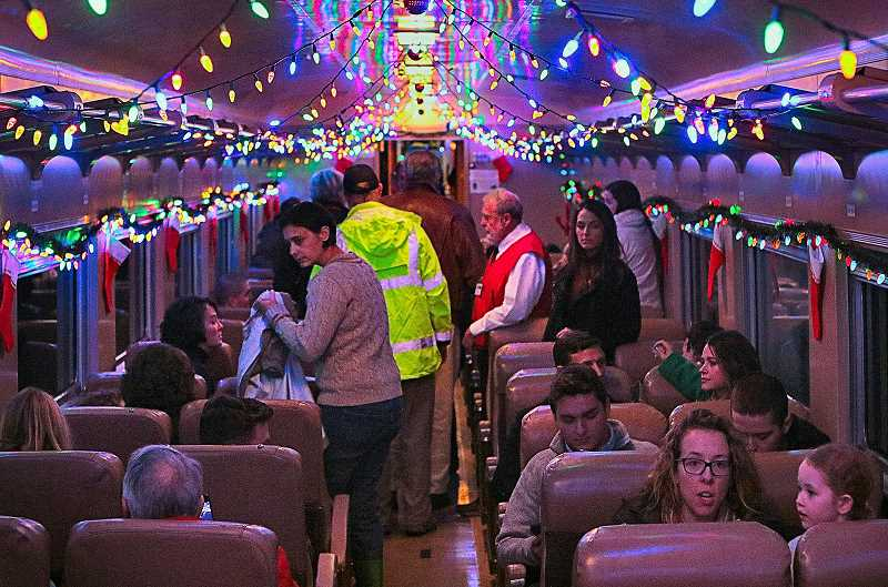 DAVID F. ASHTON - Inside the comfortably-heated vintage rail cars, festooned with decorations and Holiday lights, passengers take their seats.