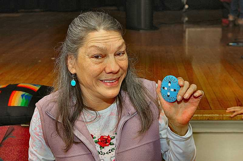 DAVID F. ASHTON - Katherine Quartz, a member of the Paiute tribe, shows her beadwork belt buckle.