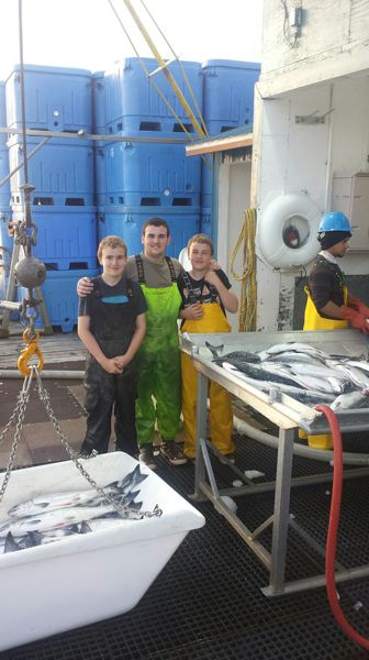 SUBMITTED PHOTO - After a fishing expedition, brothers (from left) Talon, 15, Austen, 16, and Logan Eells, 14, unload at Sitka Sound Seafoods.