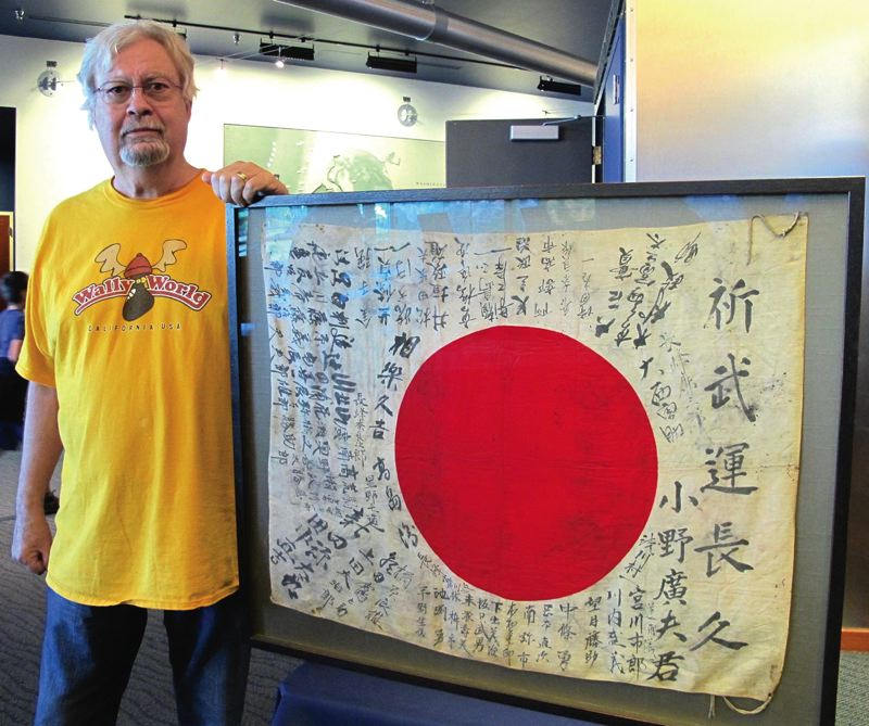 COURTESY: OBON SOCIETY - Bob Miller, former KPAM radio personality, had a flag from his father-in-law who brought it back as a battlefield souvenir from World War II. After hearing about OBON Society efforts, he decided to return the flag to Japan.
