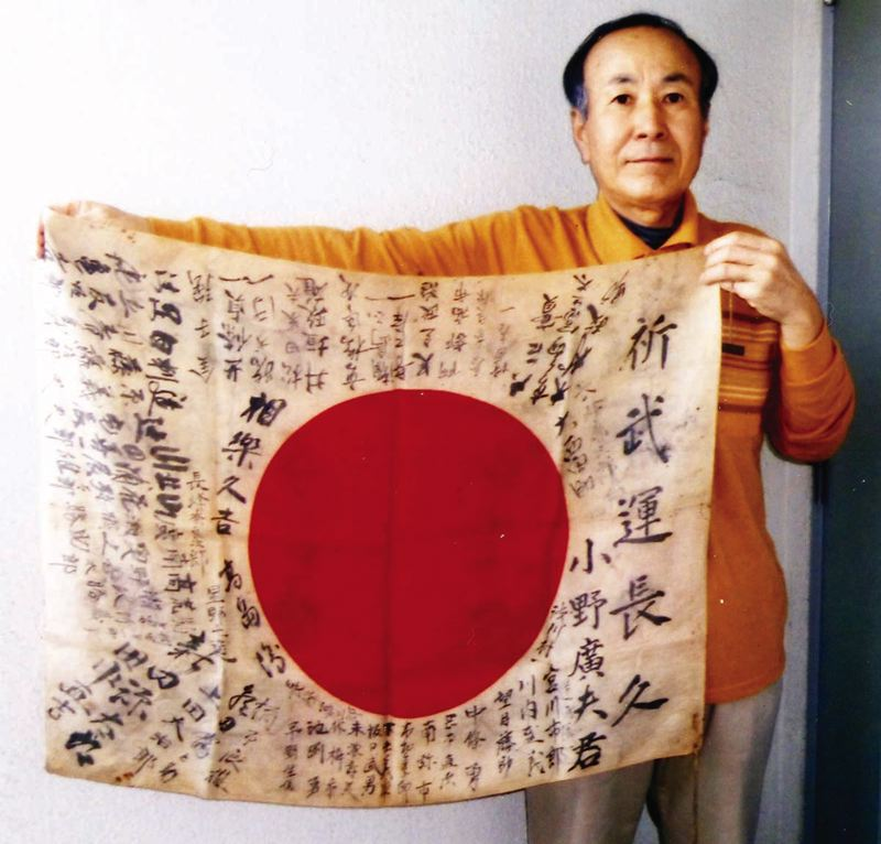 COURTESY: OBON SOCIETY - After much research, OBON Society scholars discovered that the flag was created for a man named Hiroo Ono 70 years ago. They were able to locate the nephew of the soldier and returned the flag to the family.