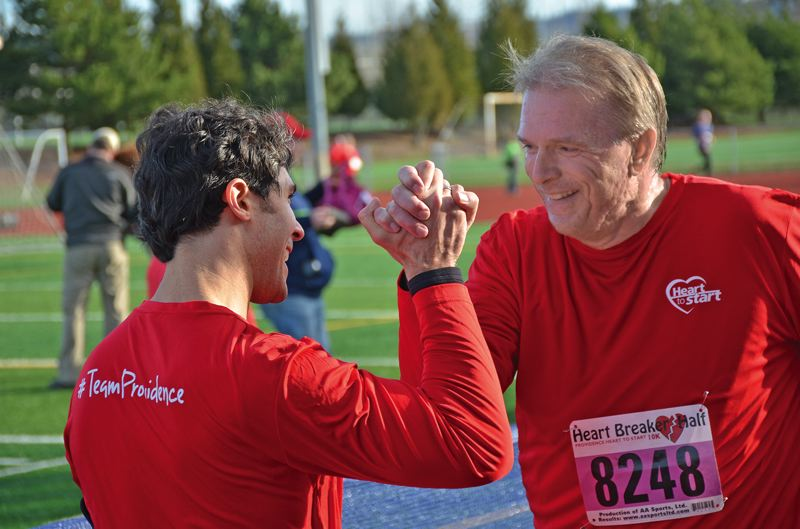 COURTESY: PROVIDENCE HEALTH AND SERVICES - Dr. Beckerman with Dave Underriner, Providence Oregon chief executive. Underriner is an avid runner and participates in the Heart to Start teams goal race each year.