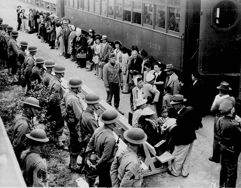 COURTESY PHOTO: CLEM ALBERS/NATIONAL ARCHIVES - Japanese citizens living on the West Coast were held in camps through the war. Here, families were assembled at San Pedro, Calif., before being taken to the camps.