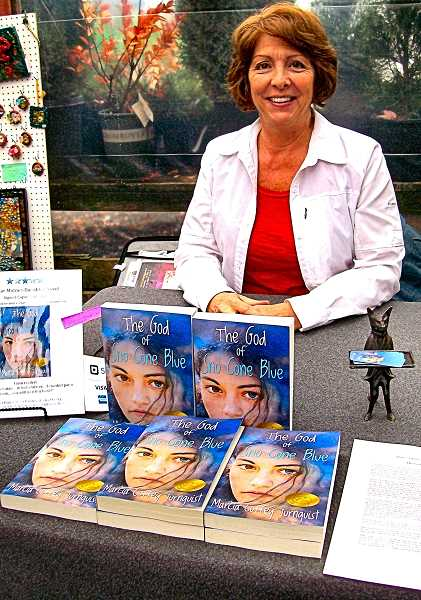 RITA A. LEONARD - At the charity bazaar, Southeast Portland author and former local TV newscaster Marcia Coffey Turnquist signed copies of her first novel, The God of SnoCone Blue.